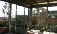 Veranda eseguita con profili Forster in acciaio inox satinato